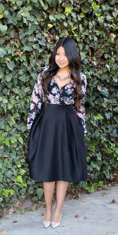 floral wrap blouse, black midi skater skirt, nude pumps, gold link necklace