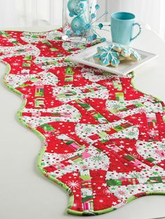 Christmas Quilt Table Runner. This is an interesting pattern.  I like it.