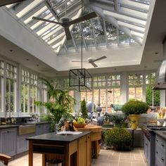 A kitchen in a greenhouse—who wouldn't enjoy spending time in this light-filled space?