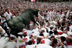 A calf jumps into the arena after the running of the bulls at the San Fermin fiestas in Pamplona, Spain. (Ivan Aguinaga/Associated Press) #photojournalism