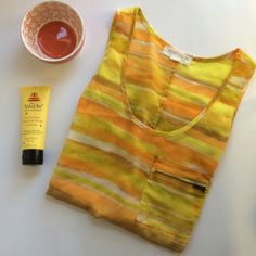 Orange and Yellow Forever 21 Essentials Tank Top This gorgeous, orange and yellow tank top by Forever 21 is perfect for dressing up to go out for a night or down when you're going for a more casual look! It's in very good condition and is a size medium! Forever 21 Tops Tank Tops