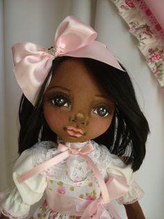 Boneca negra de pano. Soraia Flores.