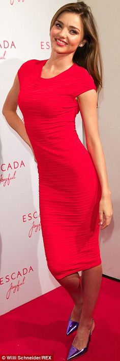 Joyful indeed! The Australian supermodel smiled and posed for the cameras as she walked the red carpet in metallic purple pumps at the glamorous event for the fragrance Joyful, of which she is the face