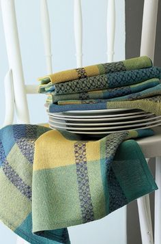 """These napkins are gorgeous no matter how they're folded, which is why designer Susan Horton calls them """"origami!"""" The silk warp threads used to create the overshot design give these towels a gorgeous shine."""
