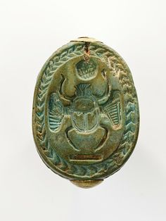 Scarab Period: New Kingdom Dynasty: Dynasty 18, early Reign: reign of Ahmose I–Thutmose II Date: ca. 1550–1479 B.C. Geography: From Egypt, Upper Egypt; Thebes, el-Asasif, Tomb CC 37, Burial 24, Carnarvon/Carter 1911 Medium: Egyptian blue, gold Gold Dimensions: L. 2.5 cm (1 in); w. 1.7 cm (11/16 in); h. 1 cm (3/8 in) Credit Line: Purchase, Edward S. Harkness Gift, 1926 Accession Number: 26.7.575 On view in Gallery 114