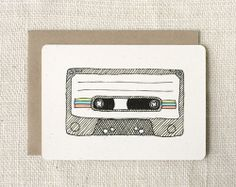 Perfect enclosure for an iTunes gift card, no? I'd personalize the graphic with suggested songs for a mixtape.