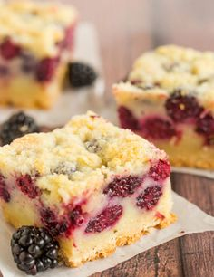 Three blackberry pie bars cut into squares.