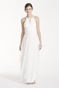 You will look breathtaking in thischarming casualwedding dress!  Sleeveless bodice features keyholeround neckline that is adorned with shimmering beads.  Cut out backdetail gives this dress a unique focal point.  Long soft layered skirt gives this dress a magical feel.  Natural waist.  Fully lined. Imported polyester. Back zip. Dry clean only.  To protect your dress, try our Non-Woven Garment Bag.