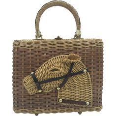 Rare and wonderful vintage wicker horse purse by Stylecraft of Miami. The figural horsehead is raised and stands out from it's background. The wicker