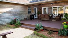 Watch this video to see how to install a pressure treated wood deck, landscape and sod a yard, and add a crushed limestone driveway.