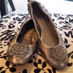 Nwot Tahari flats Beautiful silver leather with silver toe pendant. New without tags never worn. Tahari Shoes Flats & Loafers