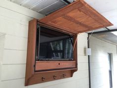 Here are our plans for an outdoor TV cabinet we built for ouroutdoor bar. Itallows us to hang wet suits and towels on the enclosure, and also houses some of the electronics we needed to run music and cable to to the patio. The wood is standard pressure treated lumber