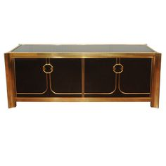 View this item and discover similar for sale at - Simply elegant brass and lacquer Mastercraft credenza with fitted interiors.