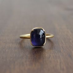 Rectangular iolite cabochon set in 18k gold with Gabriella Kiss' signature scallops.