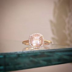 Morganite is a beautiful and feminine alternative to diamonds that our clients love! This cushion cut example has a gorgeous sparkle. Yes please!  #morganite #halo #haloring #rosegold #engagementring #engagement #engaged #pink #beautiful #diamond #handmade #shoplocal #showmeyourrings  #dreamproposal #rebekahbrooksjewelry