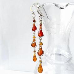 "17 Likes, 3 Comments - Tawny Reynolds (@sundropjewelry) on Instagram: ""Red and amber *triple* droplet #bohemian #earrings! Next week I'm having a 24-hour, online sample…"""