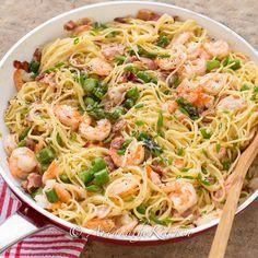 One Pan Shrimp Asparagus Carbonara Recipe Main Dishes with bacon, onions, garlic, spaghetti, large shrimp, fresh asparagus, cream, egg yolks, parmesan cheese, ground pepper, salt