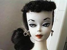 #1 barbie, no pigment/ today she has oxidized to a completely white colored doll/ holes at the soles under both feet... highly saught after, when found, VERY EXPENSIVE...