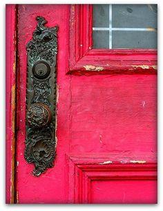 Vintage door knob on pink door