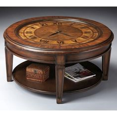 Clock Cocktail Table - Heritage - 6047070. Clock Cocktail Table - Heritage - 6047070 Selected solid woods, wood products and choice veneers. Choice maple veneers on clock face, apron and lower shelf. Includes clock mechanism which operates with one AA battery, not sup.. . See More Cocktail Tables at http://www.ourgreatshop.com/Cocktail-Tables-C695.aspx