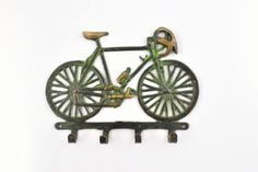 """Antique Brass racing bicycle wall Hook key hanger by Karmakara. $14.94. towels or keys. The hook is 5.5 x 7.2 inch and weighs 236 grams. """". hats. Cast in solid Brass the wall hook is a fine example of traditional hand made craft. This versatile hook may be used for hanging coats. Cast in solid Brass the wall hook is a fine example of traditional hand made craft. This versatile hook may be used for hanging coats, hats, towels or keys. The hook is 5.5 x 7.2 inch a..."""