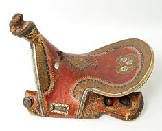 A Turkoman-Mongol hand painted lacquered wood saddle. 17th-18th c. Private collection