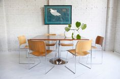 Set of 9 mid-century modern David Rowland 40/4 stacking chairs with beech-faced molded plywood seats and chromed steel rod frames.