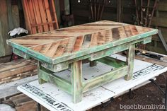 Pallet Wood Coffee Table with a base made from a wooden futon I found on the side of the road. Finished it up with a distressed paint job with…