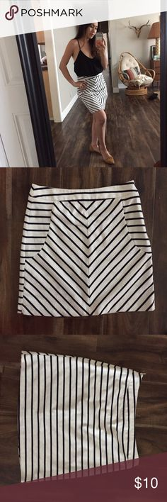 Cynthia Rowley mini skirt Really cute and comfortable.  It is polyester, rayon, and spandex so it stretches well.  I am usually a size 2, but this runs a little bigger.  You can wear this for the Winter also with some stockings and knee high boots. Cynthia Rowley Skirts Mini