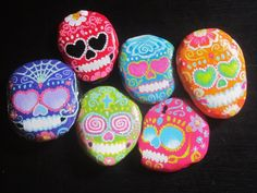 Sugar Skull Painted Rocks. Simply paint rocks with either white or vibrant acrylic paint and then add skull features (eyes, nose, teeth), decorating with sugar skull images such as flowers and hearts. (Tags: Punk sugar skull candy skull day of the dead)