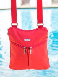 #baggallini coral horizon crossbody, beauty & function. #baggspiration we all need a little color to cheer us up