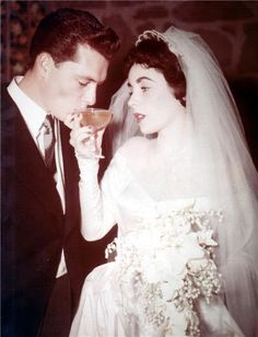 In May 1950, 18 year old Elizabeth married 23-year-old Conad 'Nicky' Hilton in anextravagantMGM staged wedding in Beverly Hills. Her dress was designed by Hollywood costume designer, Helen Rose, who also designed the wedding dress she wore in Father of the Bride, and later, Grace Kelly's wedding dress.
