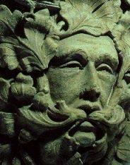 "Hauntingly wise Green Man ""speaking"" in hawthorn leaves Parish Church in Sutton Benger, UK (c.1300)"