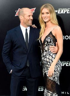 Jason Statham looks lovingly upon his girlfriend Rosie Huntington-Whiteley at the Hollywood premiere of The Expendables 3