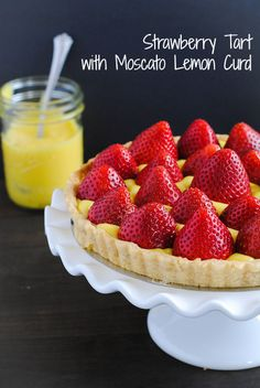 Strawberry Tart with Moscato Lemon Curd - An elegant and beautiful dessert that tastes like strawberry lemonade with a hint of moscato wine!   foxeslovelemons.com