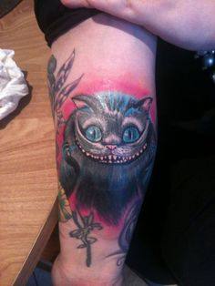 I just got this done… Alice In Wonderland was one of my favourite childhood films, but the Tim Burton version blew my mind. Especially his version of the Cheshire Cat. It fit's perfectly into my sleeve which is work in progress. All of my tattoo's are done by Snoopy, Belfast, Northern Ireland ;)