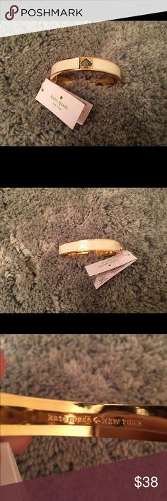 NWT ♠️KATE SPADE ♠️ BANGLE NWT WHITE KATE SPADE BANGLE.                  Price is firm, no trades! kate spade Jewelry Bracelets