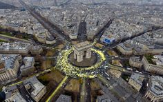 The Arc de Triomphe roundabout painted with yellow by Greenpeace activists for the United Nations Climate Change Conference, December 11, 2015. (Greenpeace via AP)