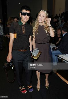 Blogger Brian Boy (L) and Editor-in-chief of Vogue Italy Franca Sozzani attend the Gucci Spring/Summer 2012 fashion show as part Milan Womenswear Fashion Week on September 21, 2011 in Milan, Italy.