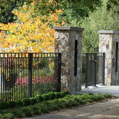 black metal fencing | Stone Gate pillars & black metal fence