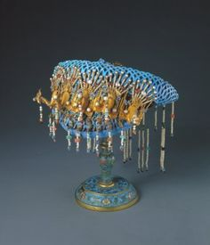 Luxurious gold, pearl and kingfisher coronet used by imperial family in Qing Dynasty. (Source: xinhuanet/photo)