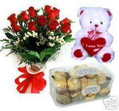 Bunch of 15 Roses with seasonal fillers wrapped in cellophane with a ribbon bows and a pack of 16...