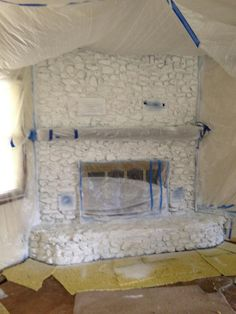 Change your old 70s fireplace with paint keep the rock look painting a stone rock fireplace solutioingenieria