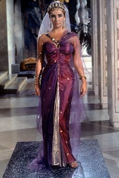 Elizabeth Taylor wearing purple garb in the 1963 Cleopatra film.