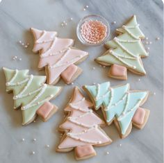 Fill in these chic christmas cookies with pink, blue, or green royal icing. Sprinkle sanding sugar on top and lay pink pearl nonpareils for decor. Get the recipe at Bake at cookies Easy Christmas Treats That'll Make Holiday Baking Even More Joyful Easy Christmas Treats, Christmas Tree Cookies, Christmas Sweets, Christmas Cooking, Noel Christmas, Christmas Goodies, Holiday Cookies, Holiday Treats, Holiday Parties