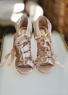 Lace-ups make them sexy, and the pastel hue is totally girlie.  Photo by Marta Locklear via Style Me Pretty
