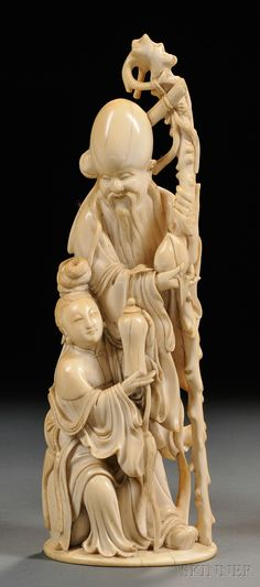 Ivory Carving, China, late 19th century, depicting Shou Lao holding a peach and a staff, accompanied by a female Immortal holding a vase, ht. 9 3/8 in.