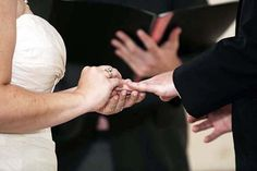 The exchanging of rings. Renée Allen Photography.