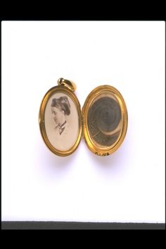 Inside of locket 'In remembrance of L.B.F. Oct 7th 1871, from C.G.S.F.', showing photograph and hair. - See more at: http://artofmourning.com/2015/09/01/jewellery-transition-from-death-to-life/#sthash.ShHoxi7W.dpuf