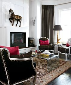 The rich velvety browns in this room are kept in check by the contemporary glass table  accessories with personality.